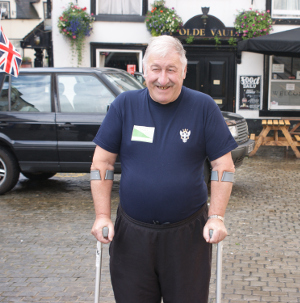 Councillor Millward sets off from Ashbourne Market Place on a sponsored walk on crutches