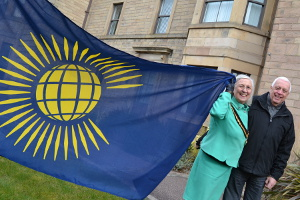 Cllrs Carol Walker and Geoff Stevens raise the Commonwealth Flag at Matlock Town Hall