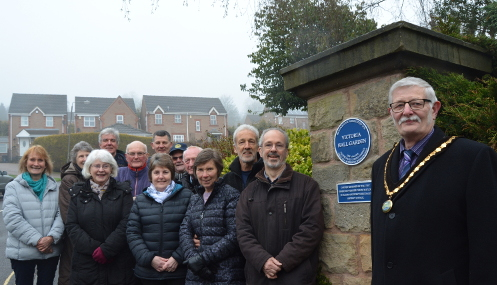 Chairman of the District of the Derbyshire Dales Councillor Steve Flitter (right) unveiling a plaque at the restored Victoria Hall Garden